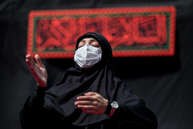 A woman attends a mourning ceremony on Ta'sua Day of Muharram Month at the Shrine of Imamzadeh Saleh, Tehran, Iran, August 29, 2020.