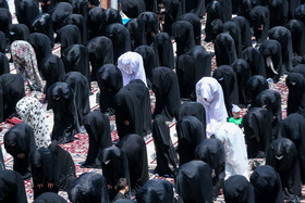 Mourners of Imam Hussain offer the noon prayer of Ashura Day at the Holy Shrine of Hazrat Abdol-azim, Tehran, Iran, August 30, 2020.