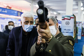 Iran's Defense Minister Brigadier General Amir Hatami (R) is seen on the sidelines of the opening ceremony of a military exhibit in Tehran, Iran, September 3, 2020.