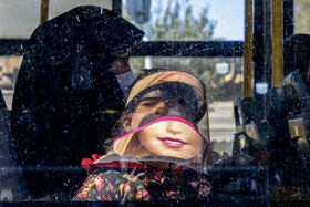 A young boy wears a face shield amid the outbreak of the coronavirus, Arak, Iran, October 19, 2020.