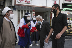 People are urged to wear face masks and follow health protocols by the officials of the Red Crescent Society of Iran to curb the spread of the coronavirus, Tehran, Iran, October 26, 2020.