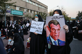 People show their disapproval of blasphemy against Prophet Muhammad in front of the French embassy, Tehran, Iran, October 28, 2020.