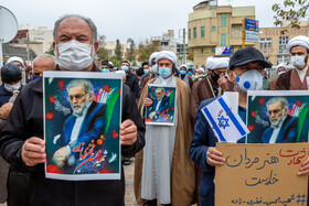 People hold a gathering to condemn the assassination of Mohsen Fakhrizadeh, Iran's top nuclear scientist, Qom, Iran, November 28, 2020.