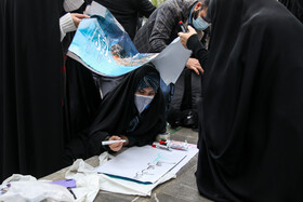 People hold a gathering to condemn the assassination of Mohsen Fakhrizadeh, Iran's top nuclear scientist, Tehran, Iran, November 28, 2020.