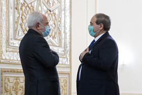 Iranian Foreign Minister, Mohammad Javad Zarif (left), welcomes his Syrian counterpart, Faisal Mekdad, in Tehran, Iran, December 7, 2020.