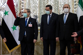 Syrian Foreign Minister, Faisal Mekdad (left), is seen before the beginning of his meeting with Iranian Foreign Minister, Mohammad Javad Zarif, in Tehran, Iran, December 7, 2020.