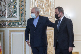 The Minister of Foreign Affairs of Azerbaijan, Jeyhun Bayramov (right), is received by Iranian Foreign Minister, Mohammad Javad Zarif, in Tehran, Iran, December 9, 2020.