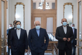 Iranian Foreign Minister, Mohammad Javad Zarif (center), is seen before the beginning of his meeting with the Minister of Foreign Affairs of Azerbaijan, Jeyhun Bayramov, in Tehran, Iran, December 9, 2020.