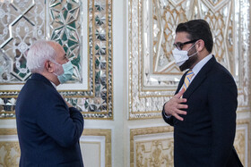 Afghanistan's National Security Adviser, Hamdullah Mohib (right), is received by Iranian Foreign Minister, Mohammad Javad Zarif, in Tehran, Iran, December 22, 2020.