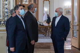 Iranian Foreign Minister, Mohammad Javad Zarif (right), is seen before the beginning of his meeting with Afghanistan's National Security Adviser, Hamdullah Mohib, in Tehran, Iran, December 22, 2020.