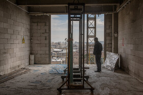 The head of the Mostazafan Foundation, Parviz Fattah, visits the construction site of the new Plasco Building, Tehran, Iran, January 15, 2021.