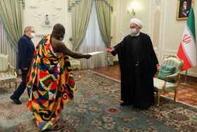 Ghana's new ambassador to Tehran, Eric Owusu-Boateng (left), presents his credentials to Iranian President, Hassan Rouhani, Tehran, Iran, February 24, 2021.