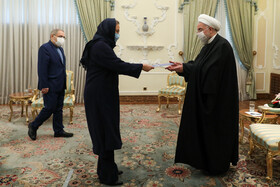 The new Romanian ambassador to Tehran, Mirela-Carmen Grecu, presents her credentials to Iranian President, Hassan Rouhani, Tehran, Iran, February 24, 2021.