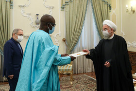 Senegal's new ambassador to Tehran, Saliou Niang Dieng (left), presents his credentials to Iranian President, Hassan Rouhani, Tehran, Iran, February 24, 2021.