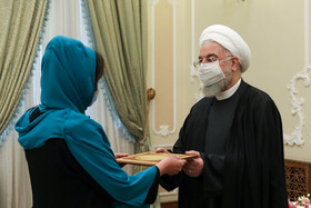 The new Bolivian ambassador to Tehran, Romina Guadalupe Pérez Ramos presents her credentials to the Iranian President, Hassan Rouhani, Tehran, Iran, February 24, 2021.
