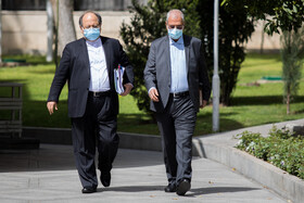 The government spokesman Ali Rabiei (right) and Minister of Cooperatives, Labor and Social Welfare Mohammad Shriatmadari are seen after the end of the meeting of Cabinet Ministers, Tehran, Iran, April 7, 2021.