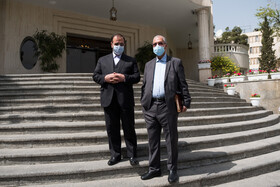 Vice President for Parliamentary Affairs Hossein-Ali Amiri (left) and the government spokesman Ali Rabiei are seen after the end of the meeting of Cabinet Ministers, Tehran, Iran, April 7, 2021.