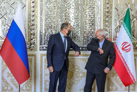 Iranian Foreign Minister Mohammad Javad Zarif welcomes Russian Foreign Minister Sergey Lavrov in Tehran, Iran, April 13, 2021.