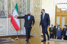 Iranian Foreign Minister Mohammad Javad Zarif (right) welcomes Russian Foreign Minister Sergey Lavrov in Tehran, Iran, April 13, 2021.