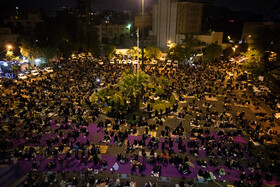 People attend the second night of the 'Laylat al-Qadr' ceremony on Palestine Square, Tehran, Iran, May 3, 2021.