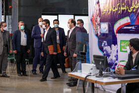 Saeed Mohammad, the former director of the Khatam-al Anbiya Construction Headquarters and a presidential hopeful, enters the headquarters of the Interior Ministry to register for the 13th presidential election, Tehran, Iran, May 11, 2021.