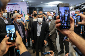 Iran's former President, Mahmoud Ahmadinejad, enters the headquarters of the Interior Ministry to register for the 13th presidential election, Tehran, Iran, May 12, 2021.