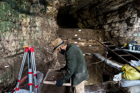 Iranian archaeologists carry out excavations in Hotu Cave, Mazandaran, Iran, June 2, 2021.