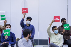 University students attend a meeting in which Alireza Zakani, one of Iran's presidential candidates, answers the questions of students, Tehran, Iran, June 2, 2021.