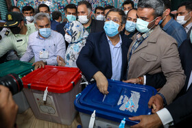 Presidential candidate Abdolnaser Hemmati casts his vote in the 13th presidential election, Tehran, Iran, June 18, 2021.
