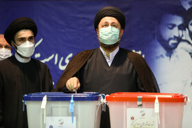 The grandson of Imam Khomeini, Hassan Khomeini (r), casts his vote in the 13th presidential election, Tehran, Iran, June 18, 2021.