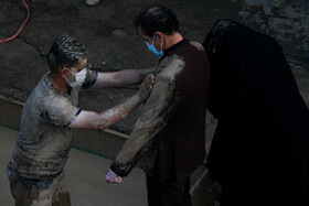 The 'Gelmali' tradition on the martyrdom anniversary of Imam Hussain (PBUH), Lorestan, Iran, August 19, 2021. According to Gelmali tradition, people apply a mixture of clay and water on their face and clothes as a sign of mourning for the martyrdom of Imam Hussain (PBUH).