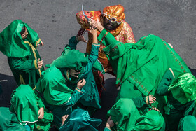 A Ta'zieh performance is held on the martyrdom anniversary of Imam Hussain (PBUH), Tehran, Iran, August 19, 2021. Ta'zieh is a traditional Persian theater, in which actors convey the dramatic events through music and songs.