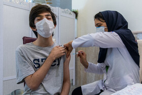 The COVID-19 vaccination of students aged 12 and over, Tehran, Iran, October 10, 2021.