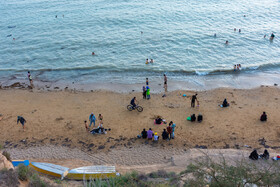 People of Bushehr spend their time on a beach amid the Covid-19 outbreak and a high number of Coronavirus patients, Iran, May 30, 2021.