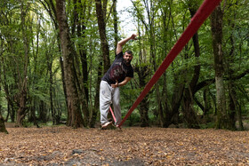 Slacklining in Gorgan, Iran, October 12, 2020. Slacklining is the activity of walking along a rope or a narrow piece of strong fabric that is stretched above the ground between two points, less tightly than a tightrope.