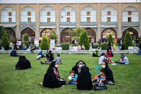 People are seen at Naqsh-e Jahan Square of Isfahan, Iran, July 29, 2020.