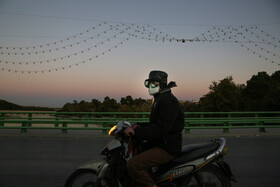 A motorcyclist is seen in a road of Isfahan city amid the third wave of the coronavirus in the city, Iran, October 14, 2020.