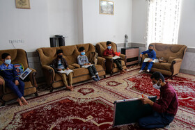 A teacher holds a class for students who do not have computers, mobile phones and needed technology for virtual learning, Razavi Khorasan, Iran, December 15, 2020.