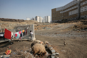 A village with no facilities is surrounded by modern buildings in Mashhad city, Iran, January 4, 2021.