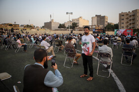 People, who support presidential candidate Ebrahim Raisi, meet at a football stadium in Mashhad, Iran, June 11, 2021.