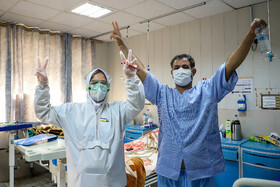 A nurse and a patient are seen in the photo at Razi Hospital, Ahvaz, Iran, March 1, 2020. Razi Hospital is the only hospital of Ahvaz in which people who have tested posotive for the new coronavirus are admitted.