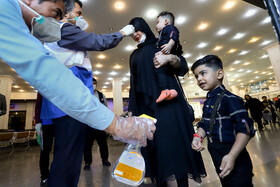 Passengers are checked at the train station of Ahvaz in order to curb the spread of the new coronavirus, Iran, March 3, 2020.