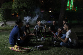 Young men smoke shisha water pipes, also known as hookah or nargile, during the coronavirus lockdown in Ahvaz, Iran, May 13, 2020. The number of coronavirus cases has considerably increased in the city.