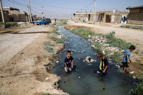 Three children are seen in an underdeveloped region of Ahvaz City, Iran, June 25, 2020.