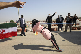 Iranian athlete, Faezeh Sarlak, sets a new world record for pulling a truck with her teeth, Khuzestan, Iran, August 31, 2020.