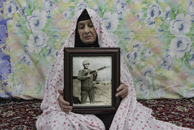 The mother of an Iranian soldier martyred during the Sacred Defense (Saddam's imposed war on Iran) is seen in the photo, Iran, September 29, 2020.