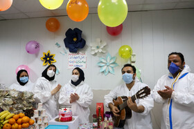Health workers celebrate Yalda Night At Razi Hospital, Ahvaz, Iran, December 20, 2020. The National Nurses Day in the 1399 year coincided with this year's Yalda Night, the longest night of the year celebrated before the beginning of winter in Iran.