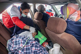 The temperature of passengers is taken in order to recognize the suspicious cases of the coronavirus, Arak, Iran, March 9, 2020.