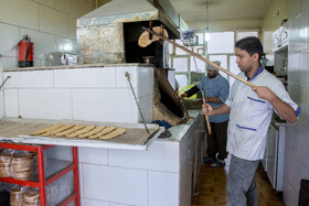 Fatir is baked in a bakery of Arak City, Iran, August 18, 2020.