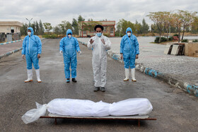The body of a coronavirus patient is seen before being buried, Saveh Cemetery, Arak, Iran, November 29, 2020.